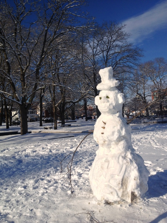 Snowman enjoys the park
