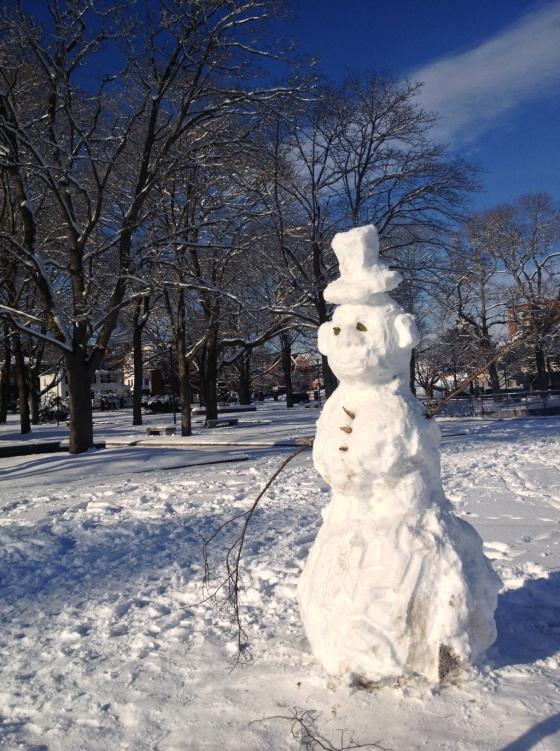 Snowman enjoys the park